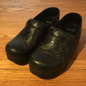 Detailed Black Dansko Clogs